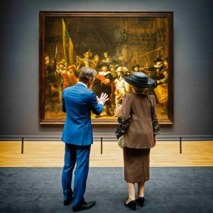 "Handout photo of Queen Beatrix of the Netherlands and museum director Pijbes looking at the painting ""The Night Watch"" by Rembrandt at the Rijksmuseum in Amsterdam"